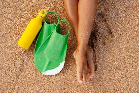 Strandflasche und Sand